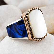Серебряные кольца с драгоценными и полудрагоценными камнями